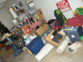 Before:  A vacant home was sold and needed the garage cleaned out and moved to storage prior to closing