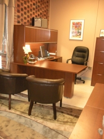 After: Professor painted, purchased new furniture, and decluttered years of build up to create an office she was happy to enter each morning