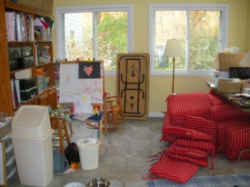 Before:  Sunroom/family workspace was a catchall