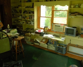 Before:  Art Studio/Home Office stalled the home owner's creativity.  Not to mention the space was dangerous because of all the boxes of stuff