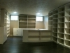 After: We painted the dated paneling, put in new hardwood floors, and custom designed storage and a work station to fit the client's needs
