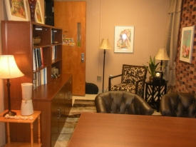 After:  Just a little decluttering allowed this professor to ditch a cabinet she thought she needed and create a very inviting seating space instead