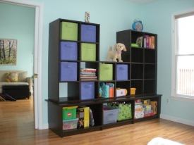 After:  A custom built toy storage unit was put in place for toys now and in the future can convert into a media center