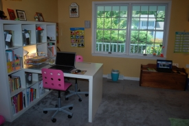 After: Playroom space is transformed!  Toys and books are easily found and put away.  Workspace is easy to get to and little girl loves her new