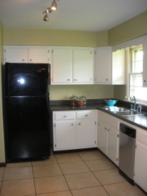 After:  Some very simple, inexpensive updates make this kitchen feel a little more with the times