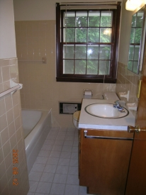 Before:  Dated bath and large vanity combine to make this bathroom less than impressive